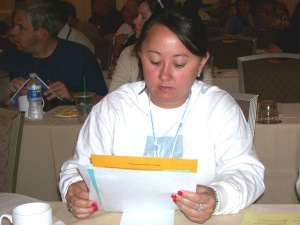 Bridgeport Education Association delegate Victoria White looks over material during the July 1 CEA caucus in San Diego. She is among 10 BEA members elected as delegates to represent their local at the 2009 NEA RA.