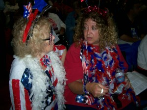 CEA Vice President Sheila Cohen (right) talks with Massachusetts delegate Kerry Costello, who is dressed in red, white, and blue to celebrate the Fourth of July.