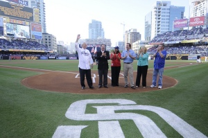 """Mullen (third from right) poses with NEA President Dennis Van Roekel (at left) and other education leaders on the pitching mound at PETCO Park. They posed before Van Roekel threw out the first pitch in front of a sold-out crowd for a game between, the San Diego Padres and the Los Angeles Dodgers on the evening of July 3. The park celebrated NEA's """"Night at the Ballpark"""" event that was attended by more than 7,000 NEA delegates."""