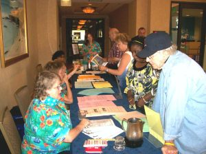 CEA RA Planning Committee members and CEA staff greet delegates as they check into the hotel.