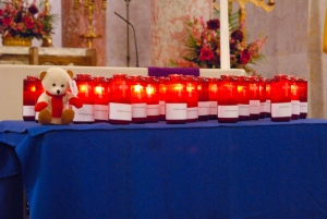 Twenty-six candles bearing the names of the victims of the Sandy Hook Elementary School mass shooting lit the altar.
