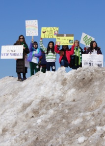 Piles of snow from the recent blizzard didn't stop people of all ages coming out to show their support.