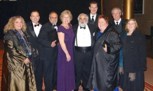 Clare Taylor, at center in purple, celebrates at the NEA Foundation Gala, with CEA leaders. From left are