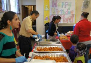 East Hartford Education Association Executive Board members serve a pasta dinner to Silver Lane families. From left are, Lia O'Connell, , and Marcia Ferreira.