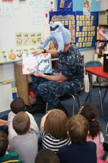 U.S. Navy sailor David Klopfer, wearing a Horton hat, while reading Horton Hears a Who! to Tamar Stearns first grade class at Charles Barnum Elementary School in Groton to celebrate Read Across America Day.