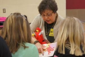 "Literacy Coach Jean Ross reads ""Clifford the Firehouse Dog"" to Silver Lane students."