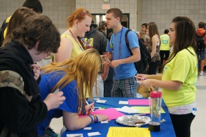 Emily Campbell, at right, talks to Lyman Memorial students visiting the booth she organized on bullying.