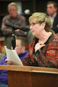 Retired teacher Jeanne Scheithe told Malloy she is concerned about the impact on teh