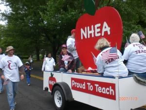 "North Haven Education Association members marched in the North Haven Memorial Day parade alongside their ""Proud to Teach"" float."