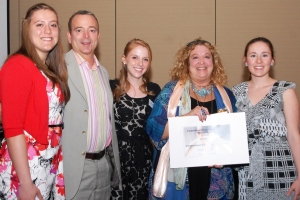 CEA Student Program Leaders (from left) Secretary Giuliana Spinelli, President Emily Oaks, and Vice President Kara Mendes present CEA President Sheila Cohen and CEA Treasurer Tom Nicholas with a $250 check to the Sandy Hook Memorial and Scholarship Fund.