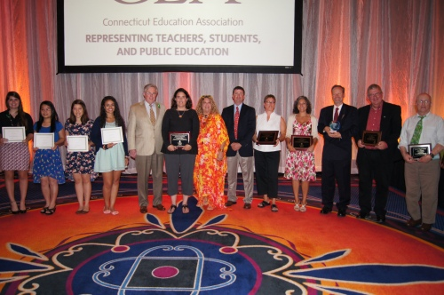 CEA President Sheila Cohen and CEA Vice President Jeff Leake pose with award winners at CEA's Annual Awards Banquet