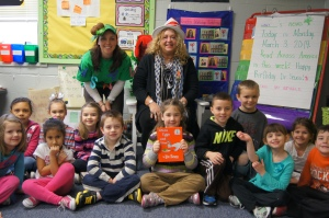"CEA President Sheila Cohen (center) posed with Berlin kindergarten students and teacher Ali Lacroix (left-dressed as the tree from the book Chica Chica Boom Boom)  after reading ""Green Eggs and Ham."""