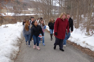 Naugatuck High School teacher Melissa McInvale leads high school students up to neighboring Western Elementary School.