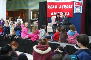 Former Olympic skater Michelle Kwan and her husband Clay Pell read to children at the Warwick Mall during an NEA Rhode Island Read Across America event.