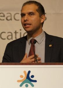 NEA Executive Board member Marty Koffman, himself a young educator, told