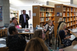 Members of the state's Common Core Task Force listen to Mark Watts of Abacus Associates explain the results of a poll of CEA and AFT members.