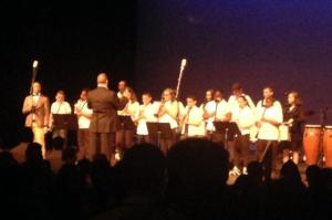 Ray Santavasi conducts the North End Middle School Band an arts workshop yesterday at the Palace Theater in Waterbury.