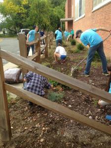 CEASP member mulch the garden outside Hopeville Elementary School.