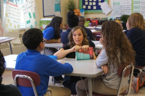 """Cara Quinn talks with her sixth graders at Sunset Ridge School about the book, """"I Am Malala."""""""