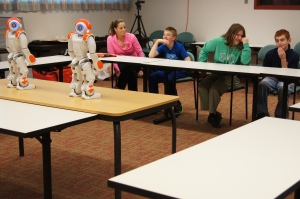 Students at River Street School in Windsor play Simon Says with the school's new robots. From left are Nick Cote, Natalie Tongue, and Jacob Brown.