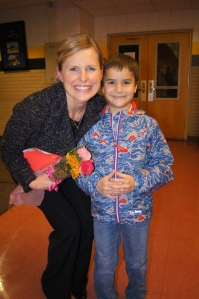 East Windsor student presents P.E. teacher with flowers to thank her for her role