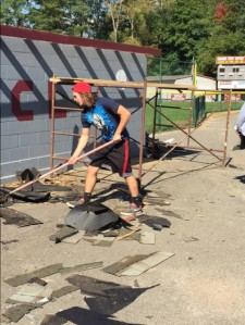 Naugatuck High School senior P.J. Murphy cleaned up debris at the Union City Little League Field.