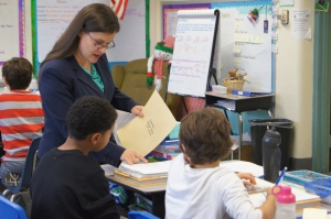 Plainville social studies speciaist Jennifer Murrihy works with fifth-grade students.