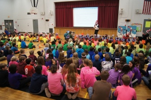 Andover Elementary School students represent all the colors of the rainbow during their all-school Read Across America assembly.