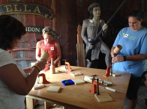 The teachers of the year tried their hand at carving ornamental parts for a ship out of wood.