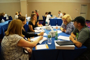 Teachers in the New Negotiators track at CEA's Summer Leadership Conference collaborate with colleagues.