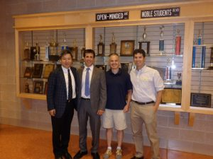 Yong Zhao, Superintendent Tom Scarice, someone, and Madison teacher Paul Coppola.