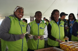 Stamford teacher Tricia Conduah along wit her twins, Jasmine and Joshua, volunteered in the food tent at the Hartford Marathon.