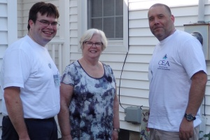 Burlington, VT teacher Andrew Styles and Vernon teacher Peter Borofsky (right) stopped to talk to East Haven teacher Kathleen Pyne at her home this summer.