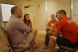 Vernon Education Association President Peter (at left) and CEA UniServ Rep Brett Pickering (2nd from right) practiced holding organizing conversations with other participants at the NEA Organizing Institute this summer.