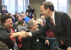 "Senator Chris Murphy greets Bridgeport teacher Gary Peluchette (at left) and Westport teacher John Horrigan (center) on Friday. Peluchette says Murphy ""gets"" teachers' opposition to DeVos."